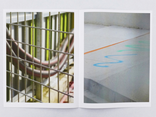 A construction fence is used as a framing element in this spread from