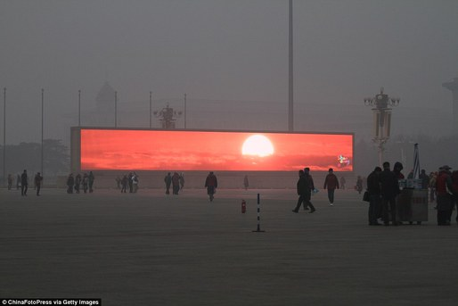 A video of a sunrise played on an screen in Beijing. Credit: ChinaFotoPress via Getty Images