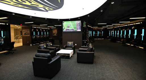 the Jaguars' locker room at EverBank Field, with wide leather chairs and 80-inch television by Daron Dean for The New York Times