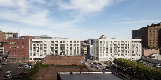 View of Residential Building VI and VII from Washington Street. Image by Scott Frances.