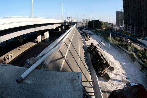 A collapsed section of the Yangmingtan Bridge's ramp, in the city of Harbin, dropped 100 feet to the ground on Friday, killing three people and injuring five. (Photo: CHINATOPIX, via Associated Press)