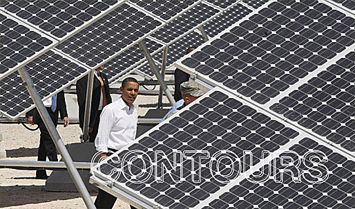President Barack Obama inspects the solar panels at Nellis Air Force Base in Las Vegas. Photo by Charles Dharapak / AP)
