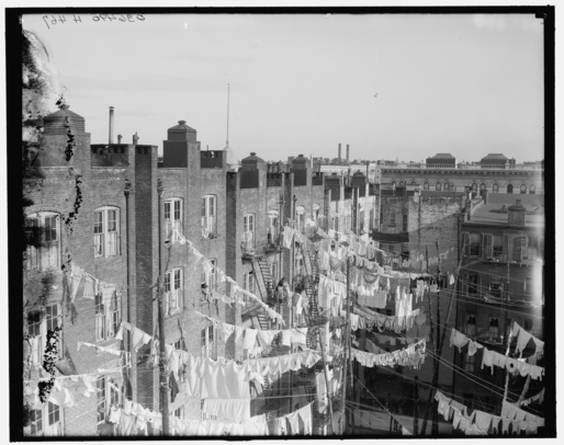Housing like this New York City tenement, photographed at the turn of the century, often didn't provide proper ventilation or access to sunlight for the residents health. Image via Wikipedia.