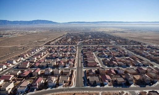 One of the existing suburban developments in the desert outside Albuquerque; beyond the city limits, land is cheaper and taxes are lower. Photograph: Trekshots/Alamy, image via theguardian.com.