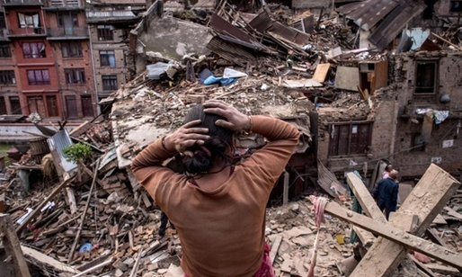A resident surveys the result of a 7.8 magnitude earthquake in Nepal (courtesy David Ramos/Getty Images).