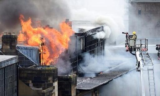 """People weeping in the streets around @GSofA Macintosh building Heartbreaking"" - Twitter user Graham McLaren (@MCLAREN_G)."