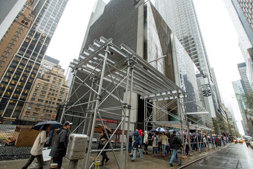 Scaffolding on the former Folk Art Museum building on West 53rd Street. Credit Ozier Muhammad/The New York Times