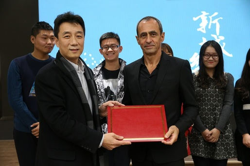 (Front row, left to right) Weimin Zhuang, Dean of School of Architecture at Tsinghua University, Beijing, China, and Keith Griffiths, Chairman of Aedas