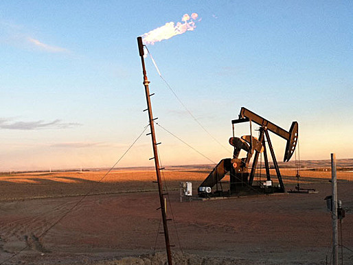 An oil pump works to extract oil from 400 billion barrels North Dakota has in reserves. (Stacey Vanek-Smith / Marketplace)