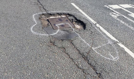 Manchester man gets potholes fixed by drawing giant penises around them