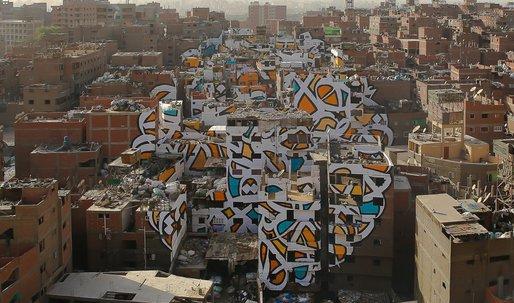 """Giant """"calligraffiti"""" mural unites community in Cairo slum"""