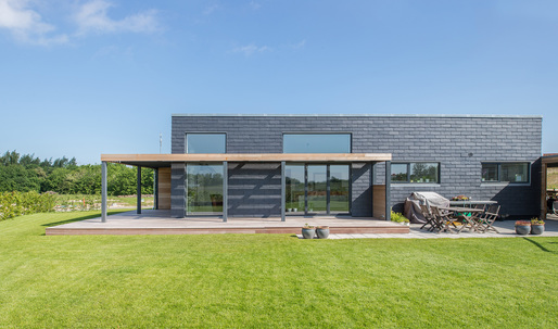 "Sustainable slate tiles dress this Danish family's energy-efficient ""Future House"""