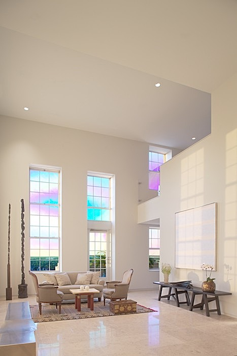 one of two double-height spaces - the living room - clg to dining room