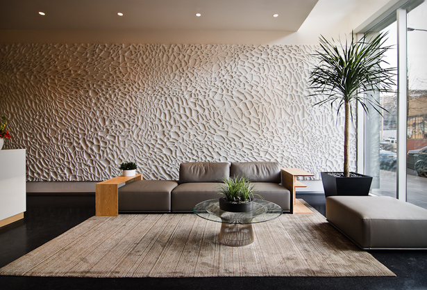 The lobby with a textured wall backdrop.