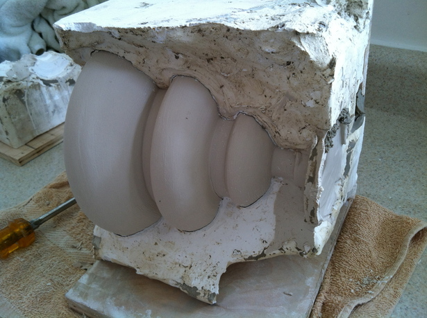 pulling apart 3part plaster mold to reveal paper clay shade in greenware state