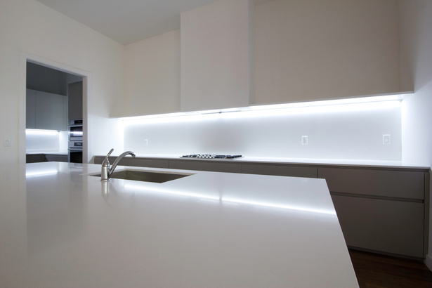 GLAM Kitchen: smooth matte gray Lacquer and CaesarStone quartz countertop.