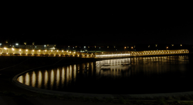 View at night across the upper lake of the west elevation of the armature