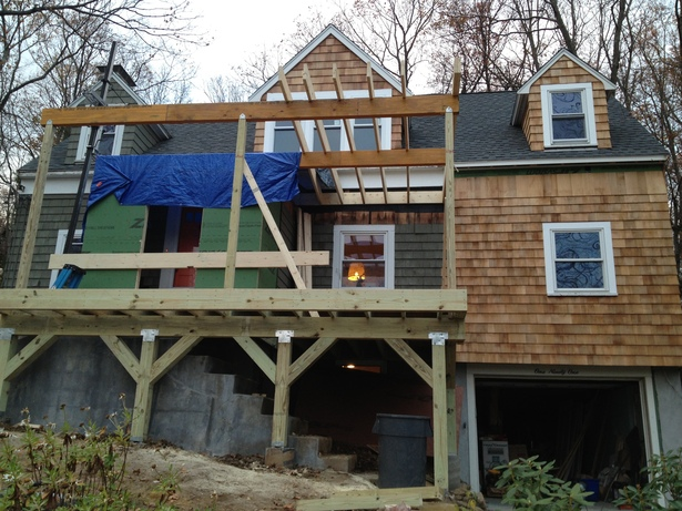 porch and entrance under construction - front view 4