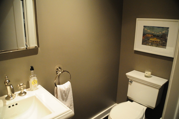 The new powder room developed from the extra hallway space.