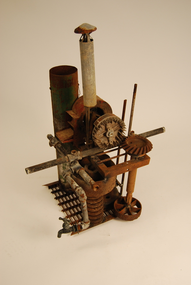 Experimental collage model of reused, welded metal parts and tubes