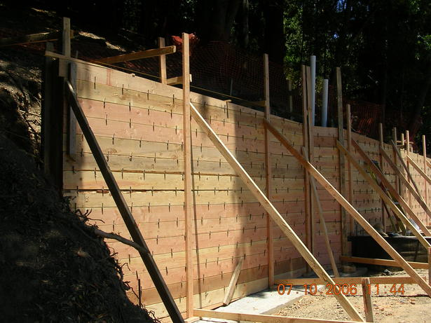 Forms at uphill retaining wall.