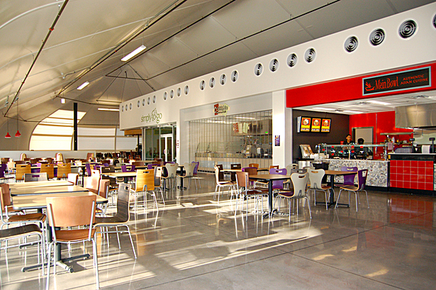 daylight floods the space, where conventional construction holds food service functions