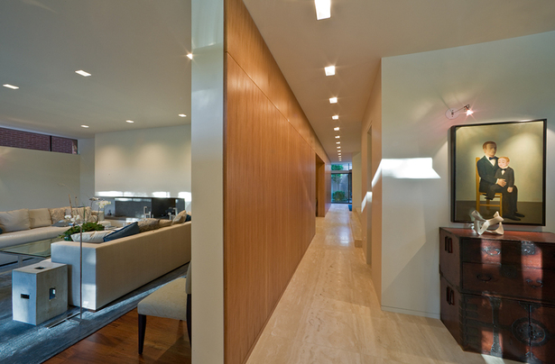 Entry foyer and wood feature wall that organizes the floor plan.