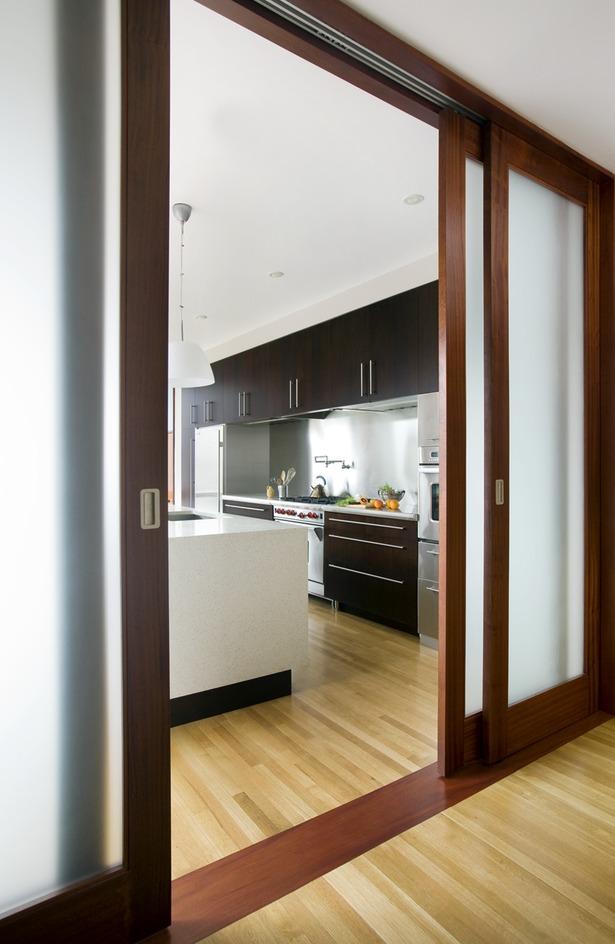 View into kitchen through sliding fogged glass doors