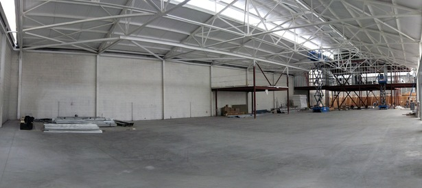 Construction interior of naturally-lit manufactory space.
