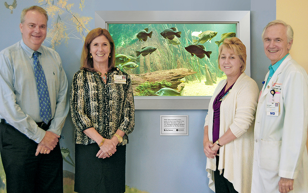 Thom Benson, Senior Communications Manager., Tennessee Aquarium, Julie Taylor, Chief Development Officer, Erlanger Health System, Cynthia Rhodes, Chief Nursing Officer, and Dr. Alan Kohrt, CEO, Children's Hospital at Erlanger.