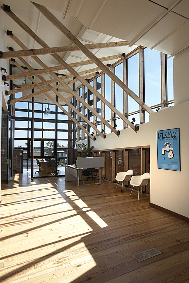 Old growth lumber was inventoried and incorporated into the structural design of the new building. In the office spaces on the second and third floors, old framing lumber has been reused in the new framing and all new wood is Forest Stewardship Council certified and harvested locally.