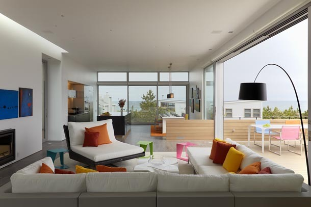 living space with kitchen beyond