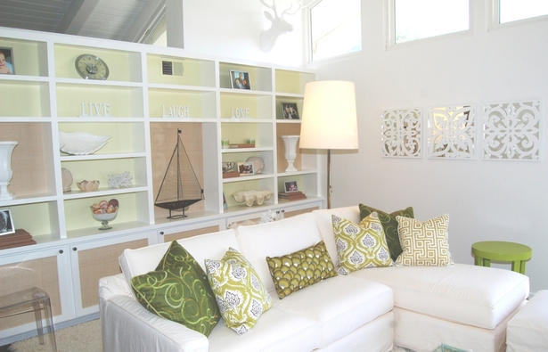 sunroom styled with custom paint & wallpapered shelves