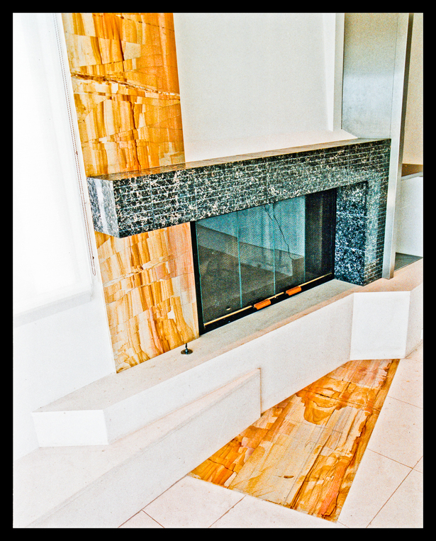 Fire place with 3 different stones, angular geometry.