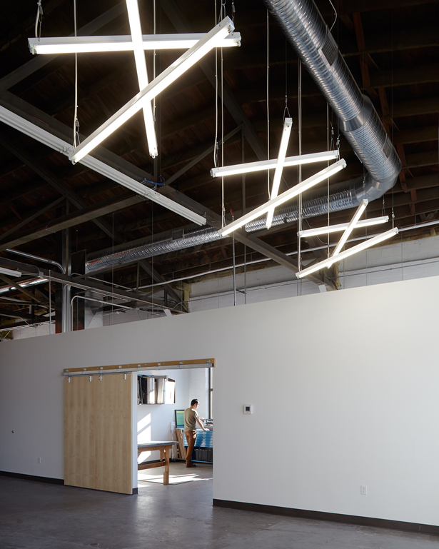 unique lighting design helped to break up the space of this vast industrial building