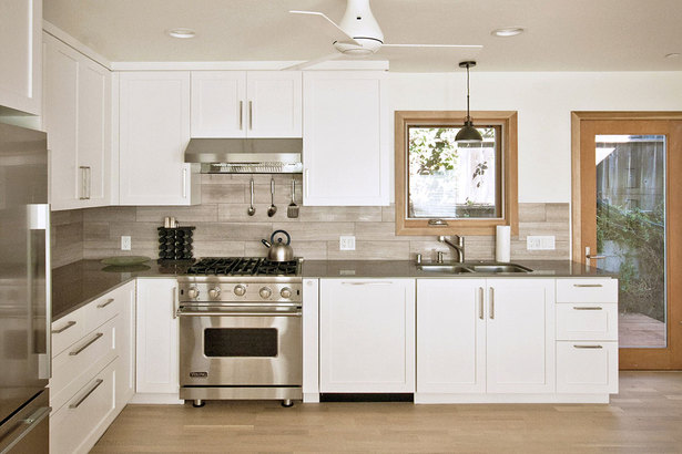contemporary custom kitchen with quartz counters, limestone backsplash + shaker details