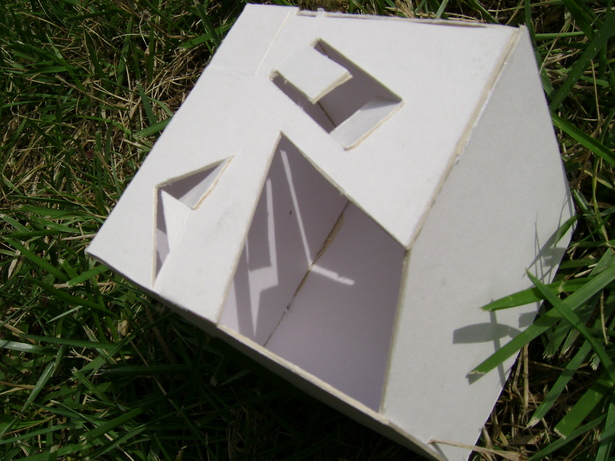 The inside of the poet's cube. The unique shapes cut into the ceiling gave pockets of spaces where there was light and darkness, which depended on the poet's attitude he wanted to take in his poetry at the time. The light and shadows produced were always changing, which could inspire.