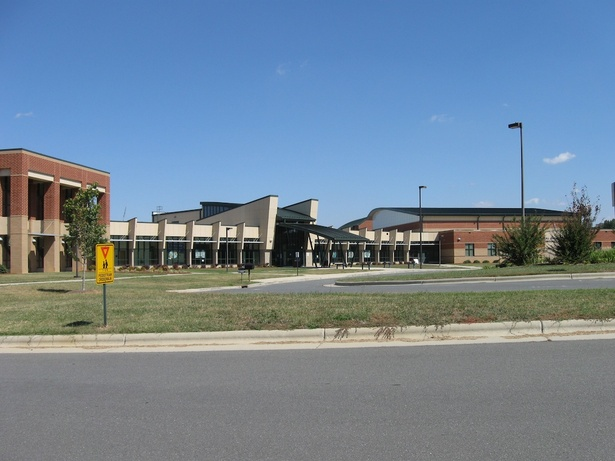 Front elevation, with (L-R) Media Center, Admin., Entry, Commons, Athletics.