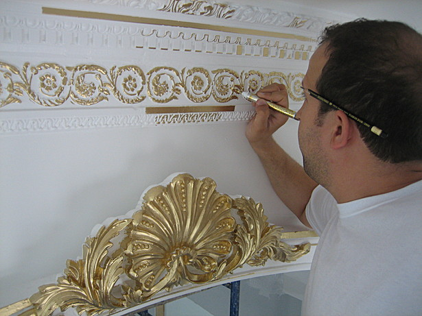 Gold leaf paint over plaster