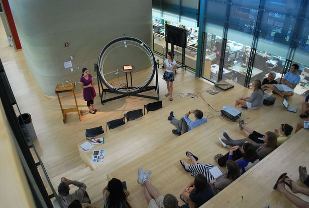 Kara Knechtel (left) and Dominique Doberneck (right) presenting the heliodon to the third year students in the Stuckeman Family Building