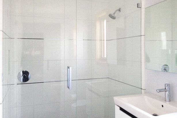 white tile, clean lines and chrome finishes in the bathrooms add a sense of openness