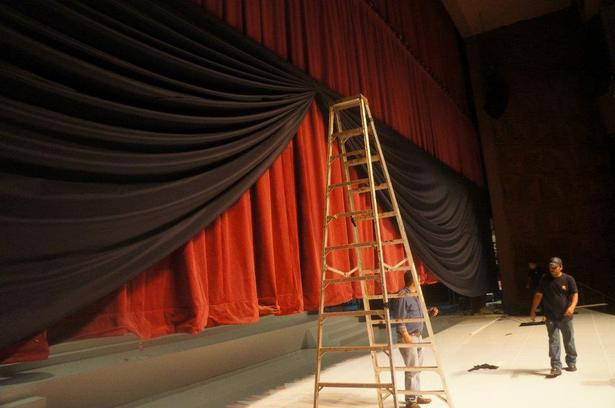 Part of the project was to frame the stage, finding an appropriate fabric, light enough to hang but still opaque and with body was one of the tasks.