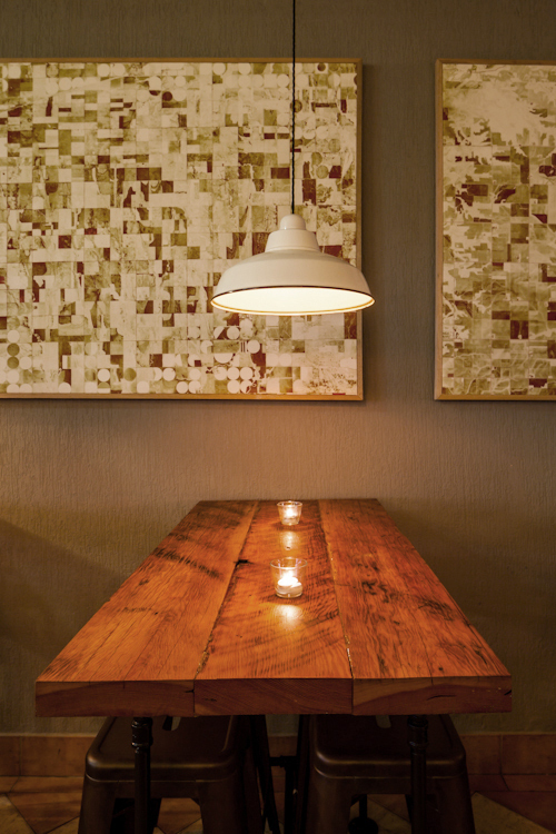 reclaimed wood + plumbing pipe tables, © 2012 Guy Wilkinson; artwork, © Ashley Couch