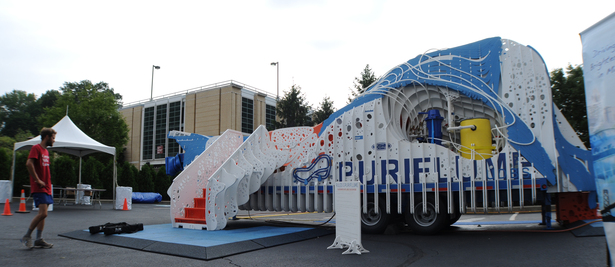 Exit side elevation view of the PURIFLUME in operation. From left to right : the exit stairs, educational track, visual systems void, and the slide entrance.