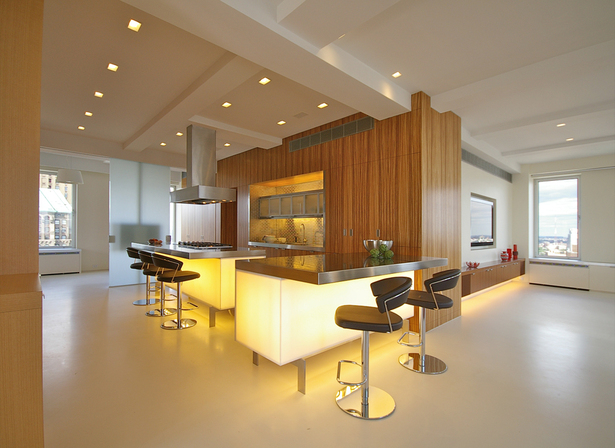 View of glowing kitchen from foyer