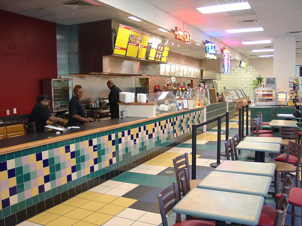 I designed all wall and floor tile layouts and patterns to match Subway's color scheme.