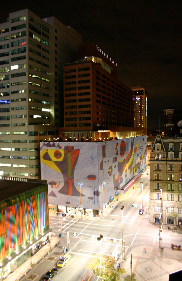 composite image of Miró mural projected onto building