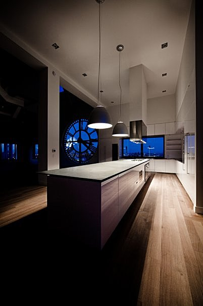 GLAM Kitchen - the cooktops are built into the countertop with separate swing-door ovens installed below.