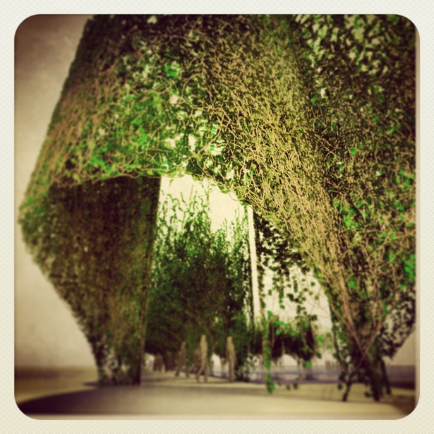 An arcade protects the topiary garden and simultaneously invites all into her world of deep memory.