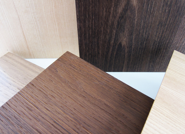 The new thicker and stronger wood doors come in a multitude of different woods and can be custom finished to match the customers' preferences.